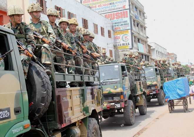 Ahmedabad: Army soldiers conduct flag march in a sensitive area of Ahmedabad on Thursday after the incidents of violence following the Patel (Patidar) community's reservation rally. PTI Photo   (PTI8_27_2015_000166B)