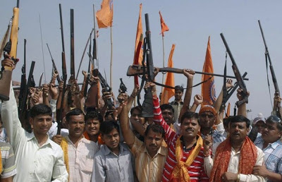 Activists of Bajrang Dal, a hardline Hindu group, hold their weapons at a temple on the occasion of Dussehra festival in the northern Indian city of Agra October 9, 2008. The Dussehra festival commemorates the triumph of Lord Rama over the Ravana, marking the victory of good over evil. REUTERS/Brijesh Singh (INDIA)
