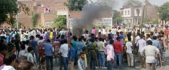 Mainpuri: Villagers vandalise properties and resort to arson in Mainpuri district on Friday over rumours of cow slaughter in the area. PTI Photo (PTI10_9_2015_000276B)