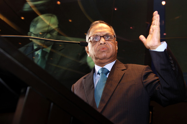 N. R. Narayana Murthy, current chairman and billionaire founder of Infosys Technologies Ltd. and soon to be chairman emeritus, speaks during a news conference in Bangalore, India, on Saturday, April 30, 2011. Infosys Technologies Ltd., India's second-largest software exporter, also promoted S. Dinesh Shibulal to the post of chief executive officer, picking the company veteran to boost earnings amid rising competition for outsourcing deals. Photographer: Namas Bhojani/Bloomberg via Getty Images *** Local Caption *** N. R. Narayana Murthy